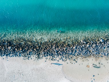 Overhead drone image of the gorgeous aqua blue waters and white sand of Tallebugdera Creek